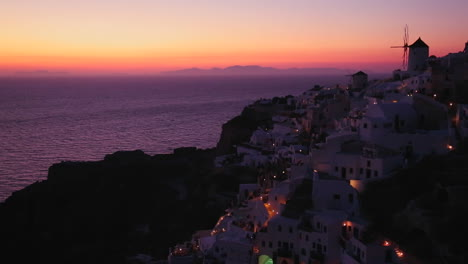 Windmills-at-dusk-or-sunset-on-the-romantic-Greek-Island-of-Santorini-at-dusk-1