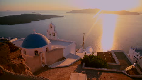 A-beautiful-sunset-behind-a-Greek-Orthodox-Church-on-the-Greek-Island-of-Santorini