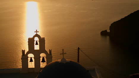 A-beautiful-sunset-behind-a-Greek-Orthodox-Church-on-the-Greek-Island-of-Santorini-1