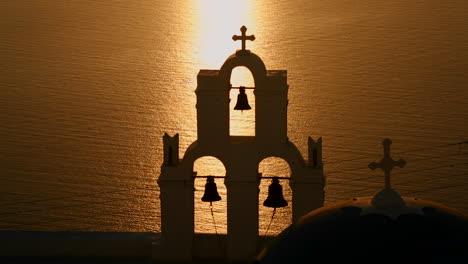 A-beautiful-sunset-behind-a-Greek-Orthodox-Church-on-the-Greek-Island-of-Santorini-2
