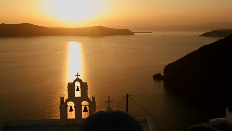 A-beautiful-sunset-behind-a-Greek-Orthodox-Church-on-the-Greek-Island-of-Santorini-3