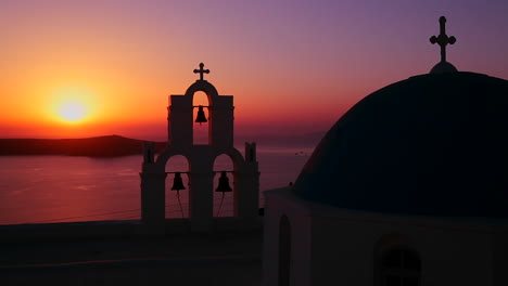 An-amazing-and-beautiful-sunset-behind-a-Greek-Orthodox-Church-on-the-Greek-Island-of-Santorini
