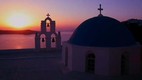 An-amazing-and-beautiful-sunset-behind-a-Greek-Orthodox-Church-on-the-Greek-Island-of-Santorini-1