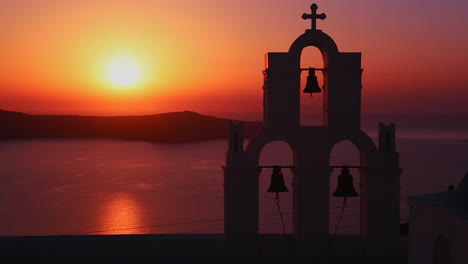 An-amazing-and-beautiful-sunset-behind-a-Greek-Orthodox-Church-on-the-Greek-Island-of-Santorini-2