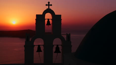 An-amazing-and-beautiful-sunset-behind-a-Greek-Orthodox-Church-on-the-Greek-Island-of-Santorini-3
