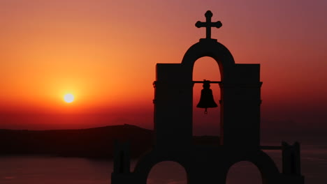 An-amazing-and-beautiful-sunset-behind-a-Greek-Orthodox-Church-on-the-Greek-Island-of-Santorini-4