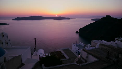An-amazing-and-beautiful-sunset-behind-a-Greek-Orthodox-Church-on-the-Greek-Island-of-Santorini-7