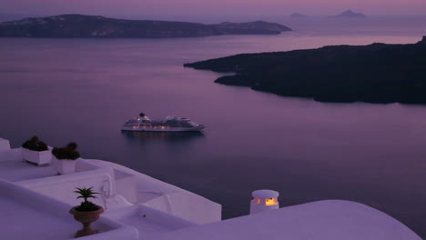 A-cruise-ship-moves-through-the-Greek-Isles-in-purple-light-at-dusk