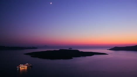 A-cruise-ship-moves-through-the-Greek-Isles-in-purple-light-at-dusk-1