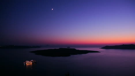 A-cruise-ship-moves-through-the-Greek-Isles-in-purple-light-at-dusk-2