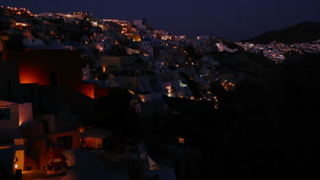 A-wide-shot-of-a-village-on-the-cliffs-of-Santorni-in-the-Greek-Islands-at-night-1