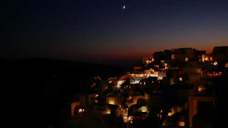 A-wide-shot-of-a-village-on-the-cliffs-of-Santorni-in-the-Greek-Islands-at-night-2