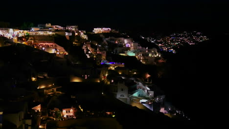 A-wide-shot-of-a-village-on-the-cliffs-of-Santorni-in-the-Greek-Islands-at-night-3