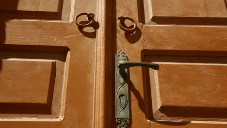 Close-detail-on-a-beautiful-wooden-door-in-a-Greek-village