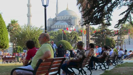 Pedestrians-walk-and-sit-on-benches-near-the-Blue-Mosque-in-istanbul-Turkey-1