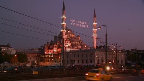 A-tram-passes-in-front-of-a-mosque-in-istanbul-Turkey-at-night