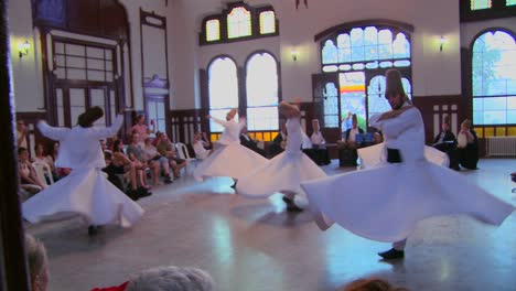 A-moving-shot-of-whirling-dervishes-perform-a-mystical-dance-in-Istanbul-Turkey