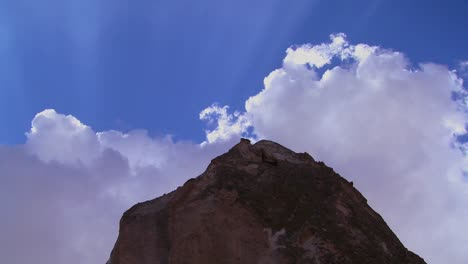 Time-lapse-of-clouds-and-sun-rays-over-strange-towering-dwellings-and-rock-formations-at-Cappadocia-Turkey
