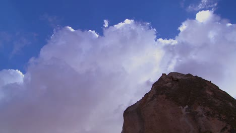 Time-lapse-of-clouds-and-sun-rays-over-strange-towering-dwellings-and-rock-formations-at-Cappadocia-Turkey-1