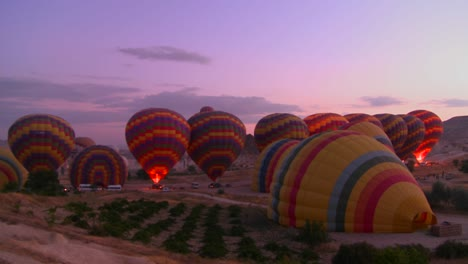 Hot-air-balloons-firing-up-at-dawn-1