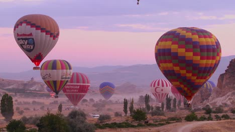 Hot-air-ballons-rise-from-the-desert-floor-in-Cappadocia-Turkey