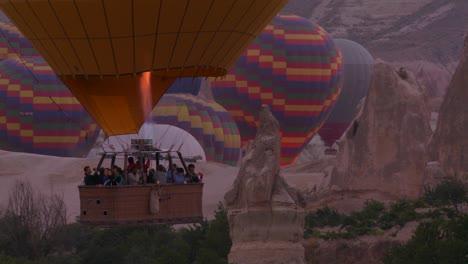 Hot-air-ballons-rise-from-the-desert-floor-in-Cappadocia-Turkey-1