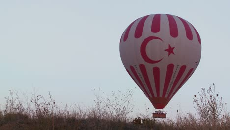 The-Turkish-flag-is-displayed-on-a-hot-air-balloon-in-Cappadocia-Turkey