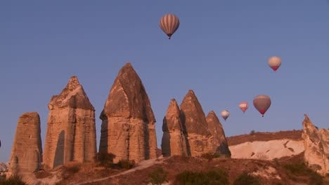 Hot-air-balloons-fly-over-the-magnificent-geological-formations-of-Cappadocia-Turkey