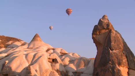 Hot-air-balloons-fly-over-the-magnificent-geological-formations-of-Cappadocia-Turkey-1