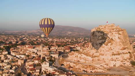 A-high-angle-of-hot-air-balloons-flying-over-the-ancient-region-of-Cappadocia-Turkey-2
