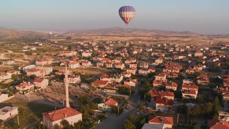 Hot-air-balloons-fly-over-a-neighborhood-near-Cappadocia-Turkey