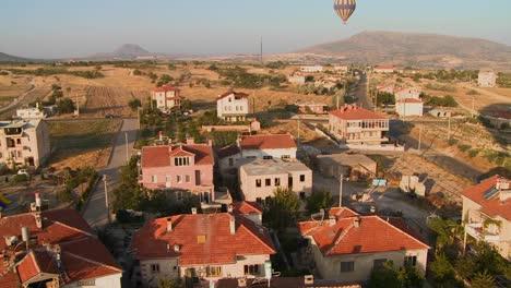 Hot-air-balloons-fly-over-a-neighborhood-near-Cappadocia-Turkey-1