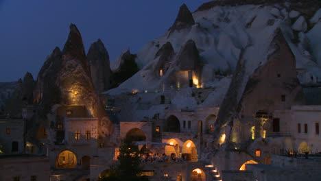 Strange-dwellings-built-into-a-hillside-at-dusk-or-night-in-Cappadocia-Turkey