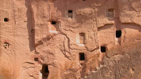 Ancient-Christian-tombs-and-carvings-on-a-cliff-face-in-Cappadocia-Turkey