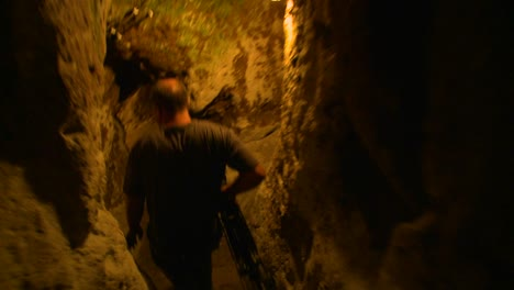 A-point-of-view-following-a-man-walking-in-a-tunnel-or-cave-in-an-underground-city-near-Cappadocia-Turkey