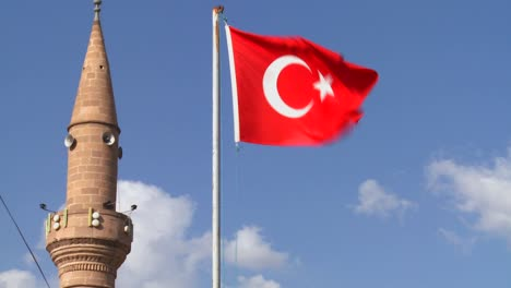 A-Turkish-flag-flies-near-a-mosque