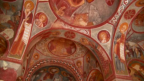 Low-angle-view-of-Christian-painted-ceilings-in-a-cave-near-Cappadocia-Turkey