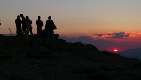 People-stand-in-silhouette-at-amanecer-of-sunset-on-the-summit-of-Mt-Nemrut-Turkey