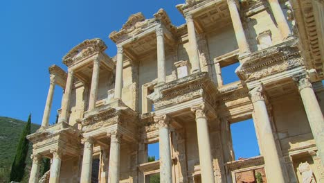 Low-angle-view-of-an-ancient-facade-at-Ephesus-Turkey
