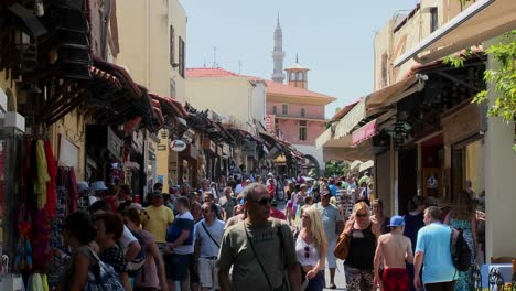 Tourists-walk-through-the-crowded-streets-of-Rhodes-Greece