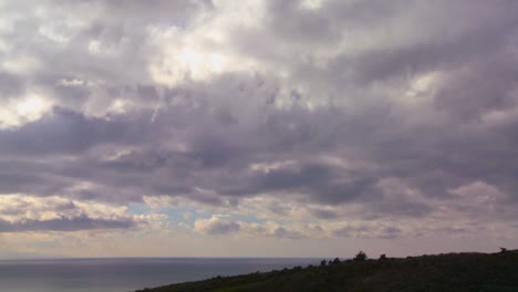 Storm-clouds-form-over-land-and-sea-in-this-time-lapse-shot