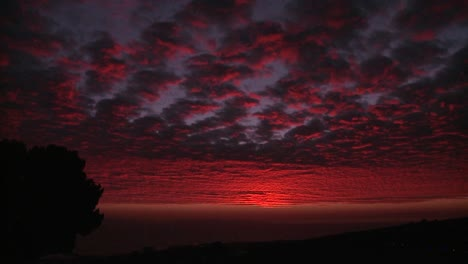 A-gorgeous-deep-crimson-sun-sets-behind-the-Channel-Islands-in-Southern-California