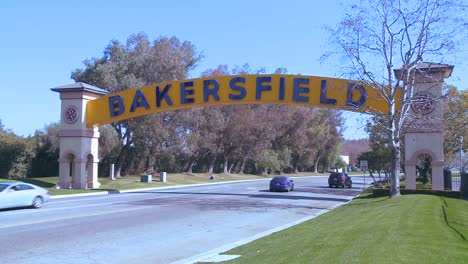 Cars-drive-into-Bakersfield-California-under-the-traditional-arched-gateway-to-the-city
