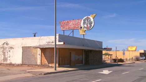 An-abandoned-liquor-store-sits-in-a-modern-ghost-town-near-Boron-California