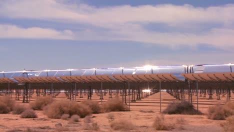 Pan-across-a-solar-farm-in-the-desert-generates-electricity
