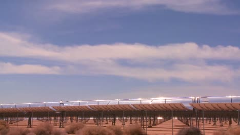 Time-lapse-of-clouds-over-a-solar-generating-farm-in-the-desert