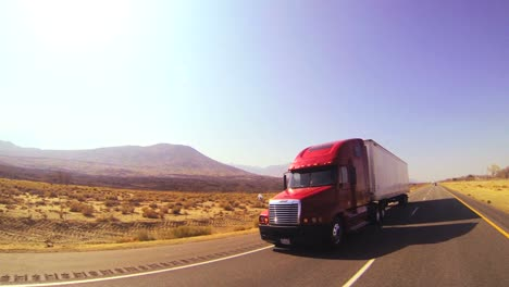 An-18-wheeler-truck-moves-across-the-desert-in-this-POV-shot