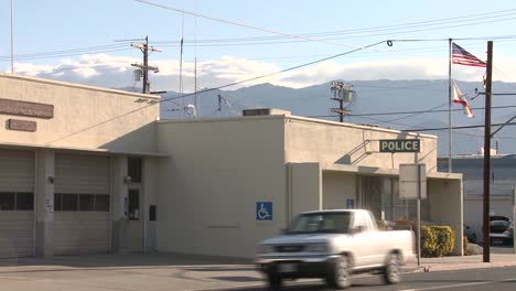 An-establishing-shot-of-a-police-station-in-an-American-town