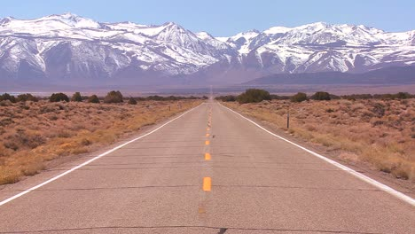 A-long-straight-lonely-road-heads-to-the-mountains
