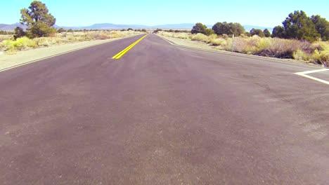POV-shot-along-a-desert-road-driving-fast